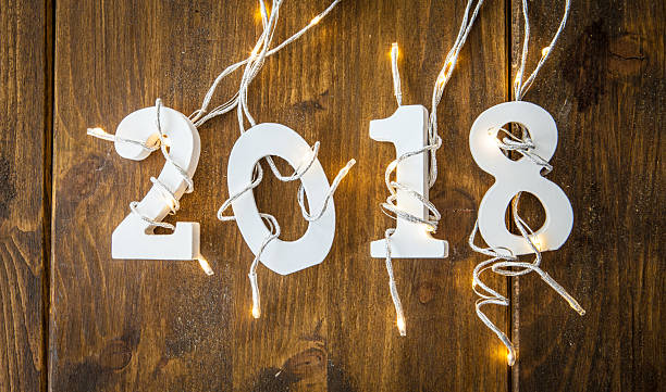 Year 2018 with christmas lights stock photo