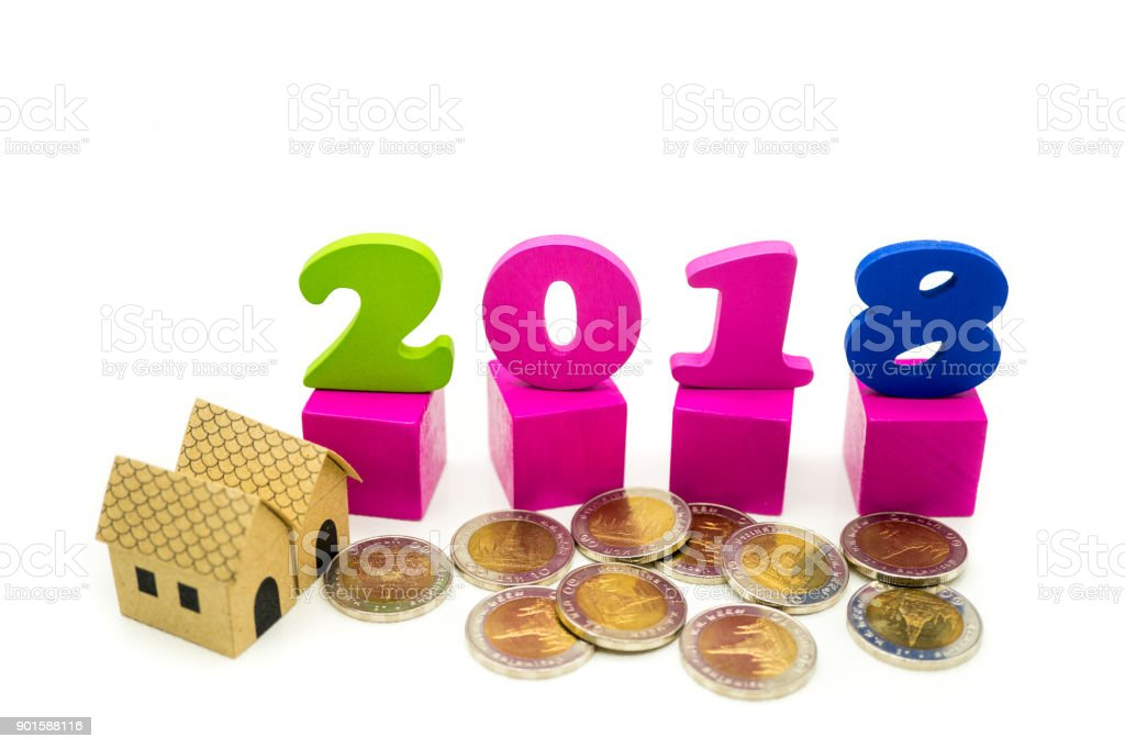 Year 2018 wooden block with paper house stock photo