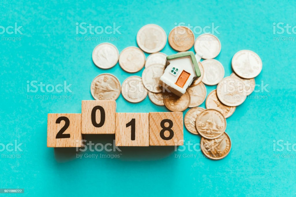 Year 2018 wooden block with stack coins stock photo