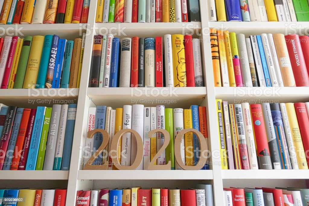 Year 2020 standing on library shelf