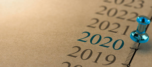 Year 2020, Two Thousand And Twenty Timeline 3D illustration of a timeline on kraft paper with focus on 2020 and a blue thumbtack. Year two thousand and twenty image focus technique stock pictures, royalty-free photos & images