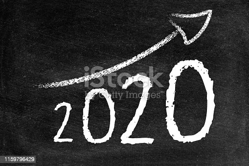 istock Year 2020 with ascending arrow on blackboard 1159796429