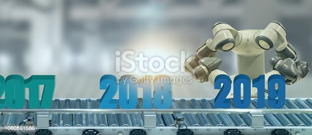 1042088340 istock photo 2019 year artificial intelligence or ai futuristic concept,  assistant robot try to put number of new year coming 2019 on operation line, industry 4.0 trend of automation robot in 2019 future 1060861586