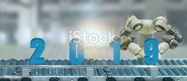 1042088340 istock photo 2019 year artificial intelligence or ai futuristic concept,  assistant robot try to put number of new year coming 2019 on operation line, industry 4.0 trend of automation robot in 2019 future 1060861604