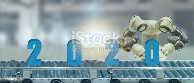 1042088340 istock photo 2020 year artificial intelligence or ai futuristic concept,  assistant robot try to put number of new year coming 2020 on operation line, industry 4.0 , 5.0 trend of automation robot in 2020 future 1133584716