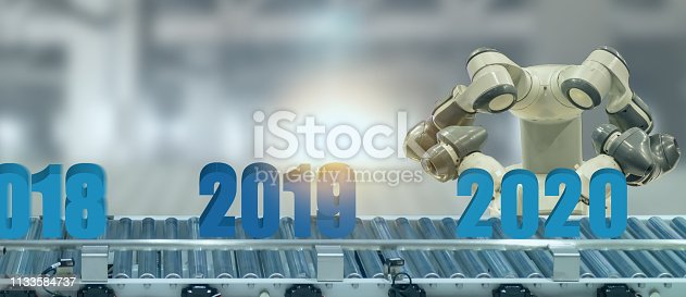 1042088340 istock photo 2020 year artificial intelligence or ai futuristic concept,  assistant robot try to put number of new year coming 2020 on operation line, industry 4.0 , 5.0 trend of automation robot in 2020 future 1133584737