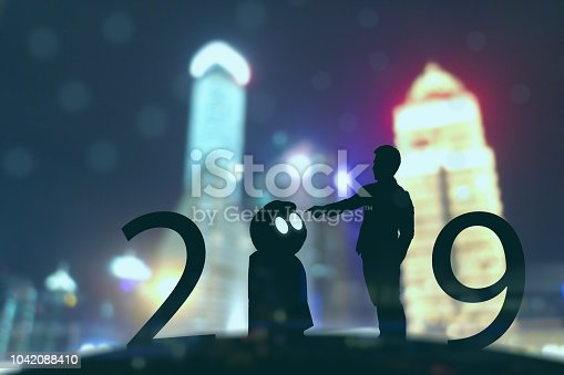 1042088340 istock photo 2019 year artificial intelligence or ai futuristic concept, Silhouette  Business man stand and point hand to command or control assistant robot, industry 4.0 trend of automation robot in 2019 future 1042088410