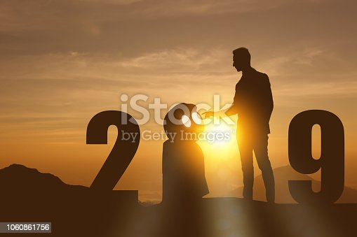 1042088340 istock photo 2019 year artificial intelligence or ai futuristic concept, Silhouette  Business man stand and point hand to command or control assistant robot, industry 4.0 trend of automation robot in 2019 future 1060861756