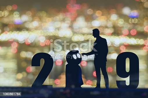 istock 2019 year artificial intelligence or ai futuristic concept, Silhouette  Business man stand and point hand to command or control assistant robot, industry 4.0 trend of automation robot in 2019 future 1060861784