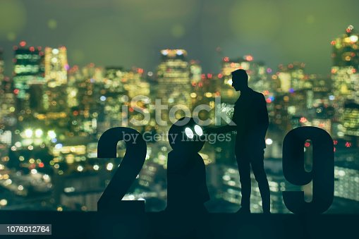 1042088340 istock photo 2019 year artificial intelligence or ai futuristic concept, Silhouette Business man stand and point hand to command or control assistant robot, industry 4.0 trend of automation robot in 2019 future 1076012764