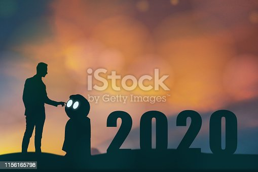 1042088340 istock photo 2020 year artificial intelligence or ai futuristic concept, Silhouette  Business man stand and point hand to command or control assistant robot, industry 4.0 trend of automation robot in 2020 future 1156165798