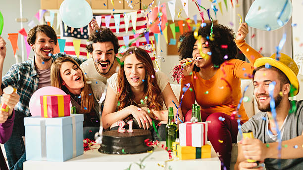 21 year Birthday Party Friends celebrating a birthday party. happy birthday stock pictures, royalty-free photos & images