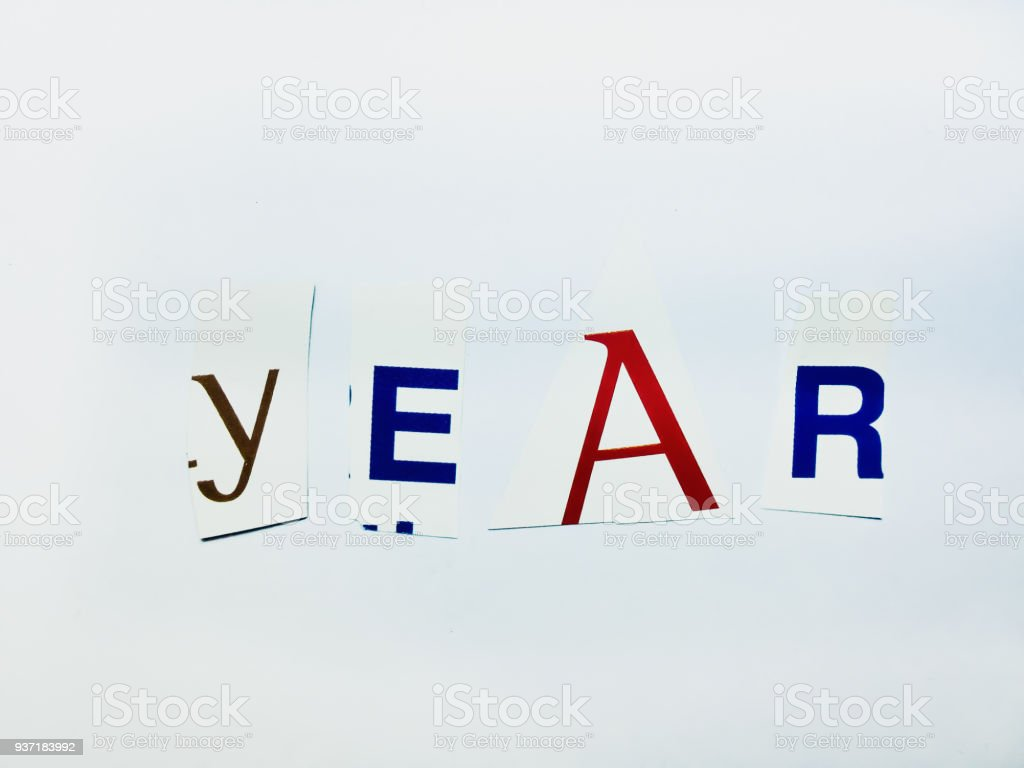 Year - Cutout Words Collage Of Mixed Magazine Letters with White Background stock photo
