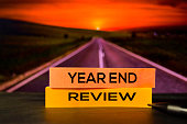 istock Year End Review on the sticky notes with bokeh background 1158519246