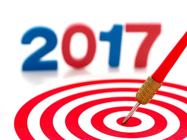 2017 year goal, red bullseye dart arrow hitting center dartboard - call center stockfoto's en -beelden
