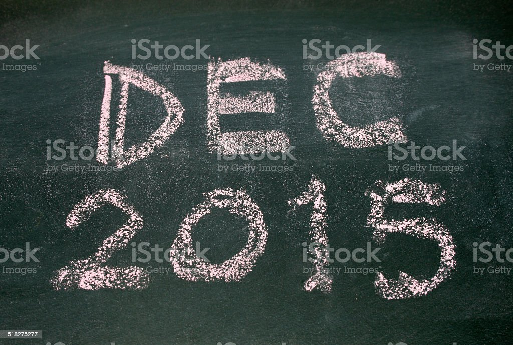 Year number 2015 and dec written with chalk on blackboard stock photo