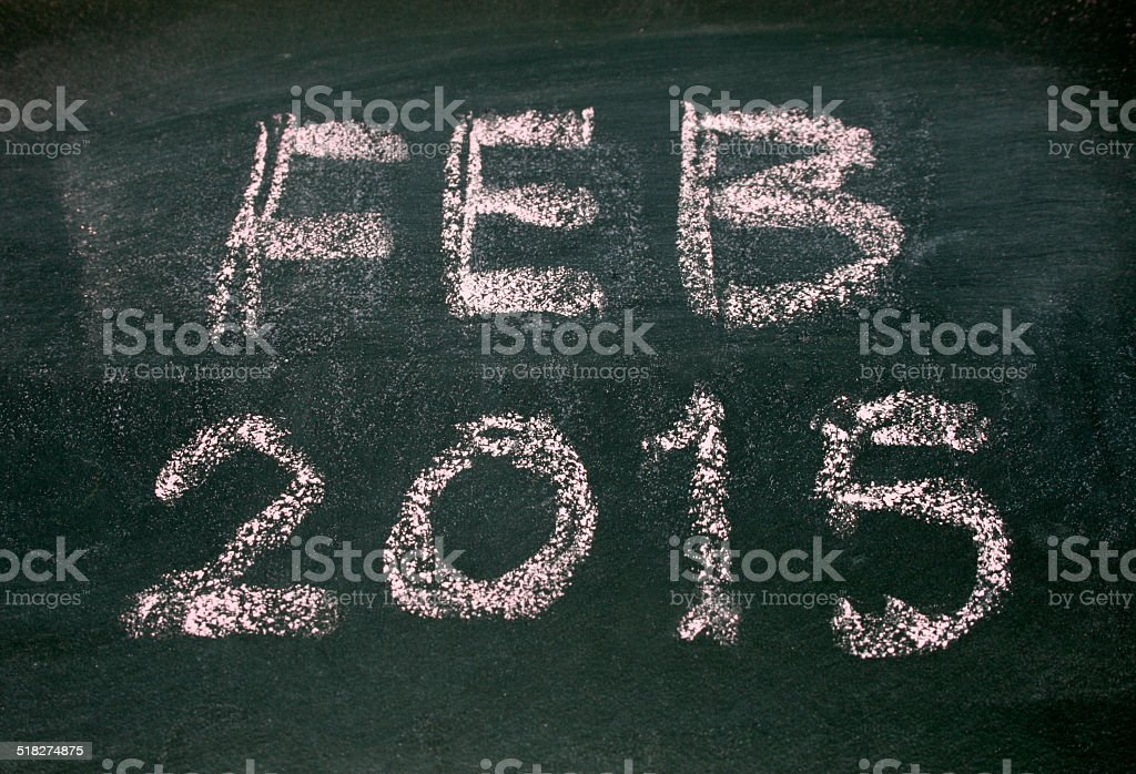 Year number 2015 and feb written with chalk on blackboard stock photo