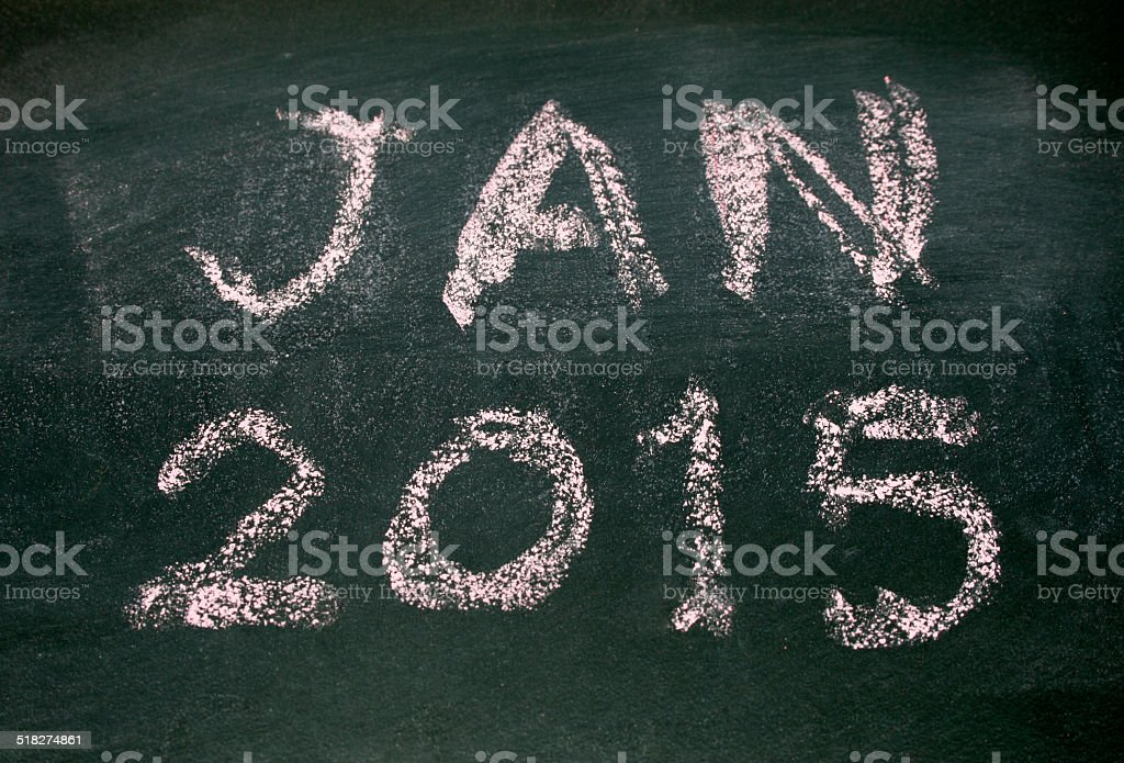 Year number 2015 and jan written with chalk on blackboard stock photo