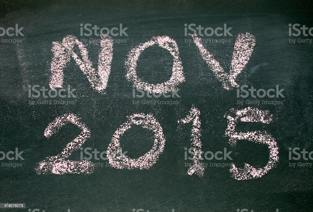 Year number 2015 and nov written with chalk on blackboard stock photo