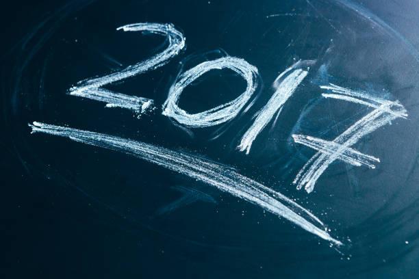 year number 2017 written with the white chalk on the - sprüche zum firmenjubiläum stock-fotos und bilder