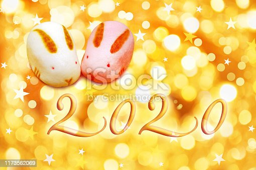 istock 2020, year of the rat,  japanese greeting card with pastries and golden background 1173562069