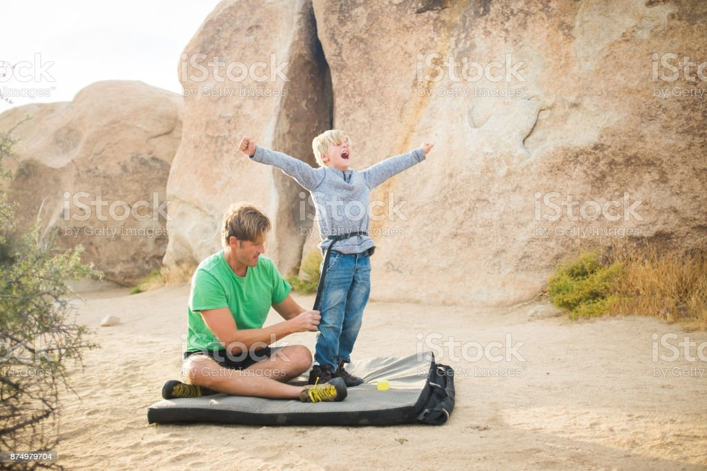 7 Year Old and Dad High Desert Bouldering stock photo