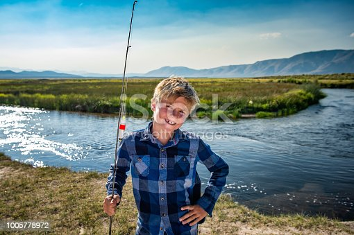 7 Year Old Boy Fishing On A River