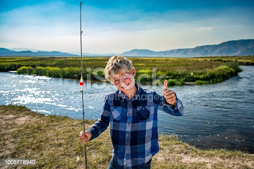 7 Year Old Boy Fishing On A River Thumbs Up