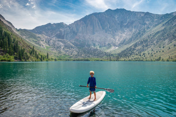 6 Year Old Boy On A Paddle Board stock photo