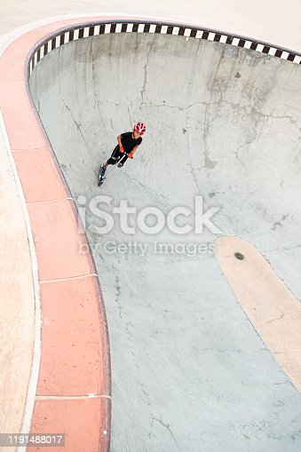 472091427 istock photo A 7 Year Old Boy On A Scooter At The Skate Park 1191488017