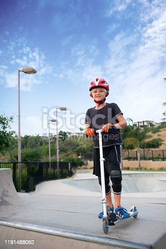 472091427 istock photo A 7 Year Old Boy On A Scooter At The Skate Park 1191488052