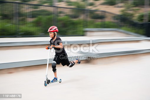 472091427 istock photo A 7 Year Old Boy On A Scooter At The Skate Park 1191488176
