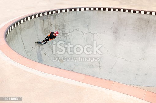 472091427 istock photo A 7 Year Old Boy On A Scooter At The Skate Park 1191488312