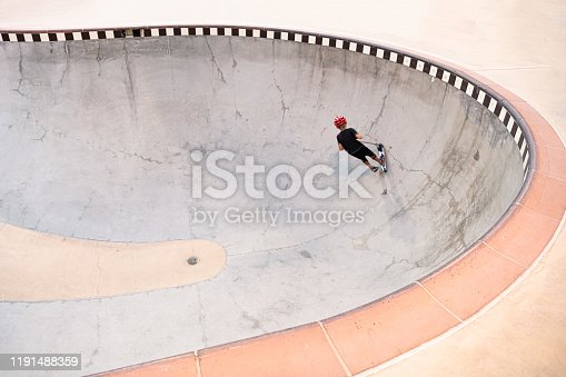 472091427 istock photo A 7 Year Old Boy On A Scooter At The Skate Park 1191488359