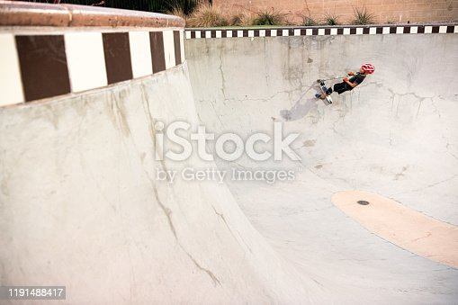 472091427 istock photo A 7 Year Old Boy On A Scooter At The Skate Park 1191488417
