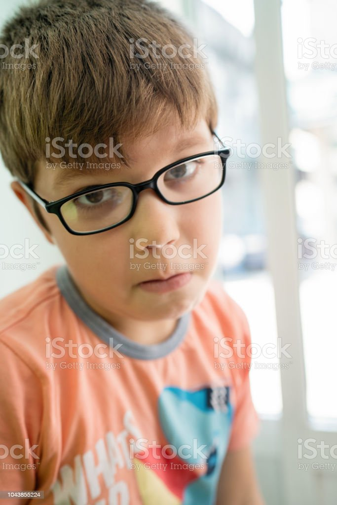 8b835d01cdd3 7 Year Old Boy With Different Face Expression Stock Photo - Download ...
