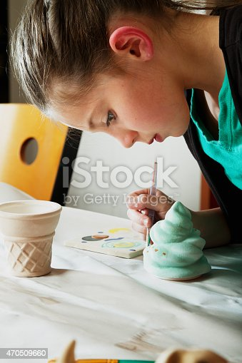 154371635istockphoto 8 Year Old Caucasian Girl Painting Pottery 470509660