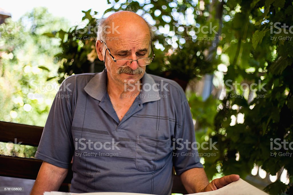 70 year old elder senior man portrait stock photo