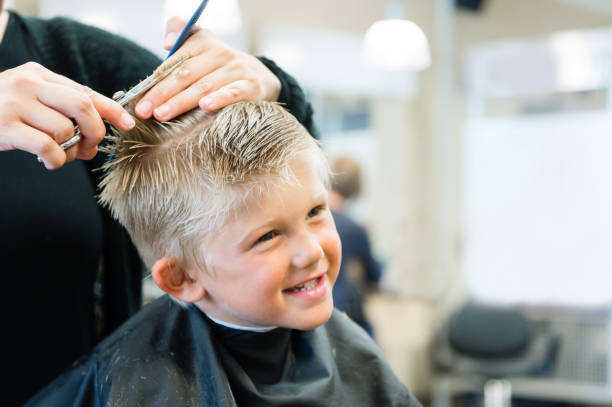 5 year old getting a haircut - hairstyle stock photos and pictures