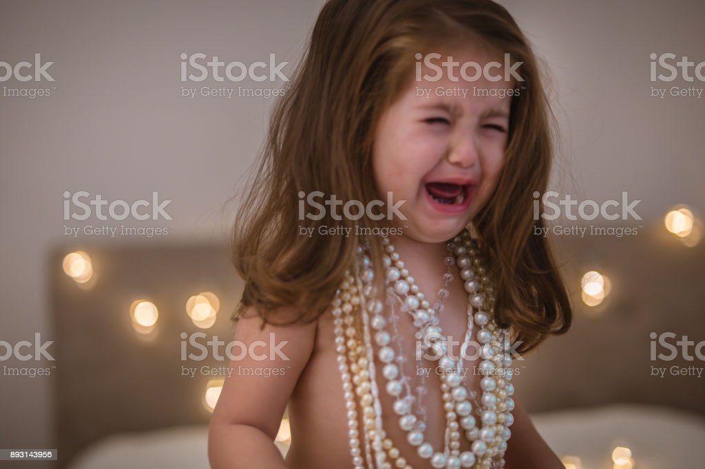 2 year old girl in tears stock photo