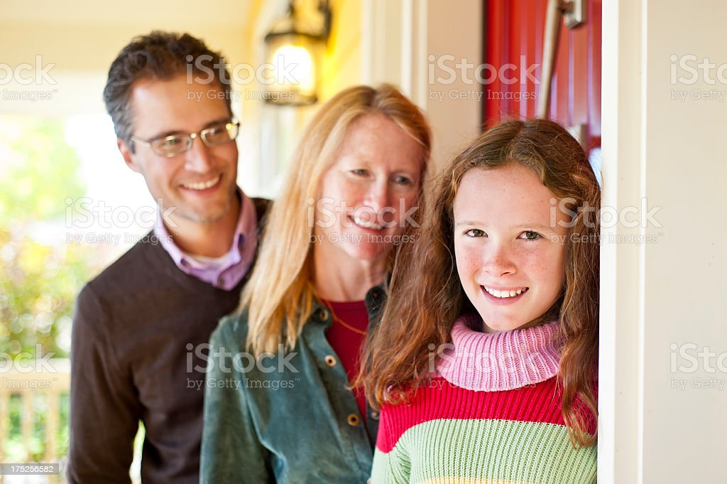 12 year old girl on home porch with happy smile stock photo