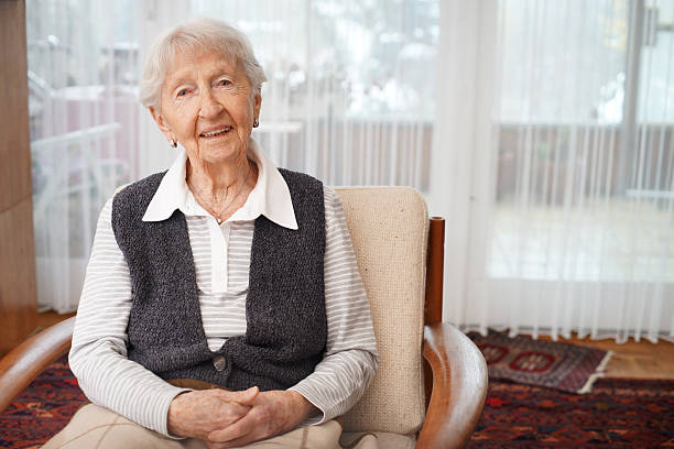 90 year old lady at home - fragile stock pictures, royalty-free photos & images