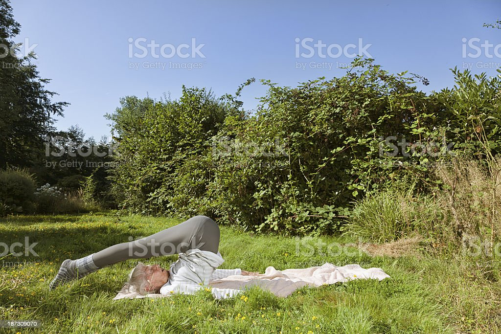 90 year old senior woman exercising outdoors royalty-free stock photo