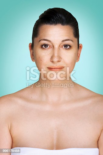 Welcome to your 50s. Portrait of woman looking at camera.
