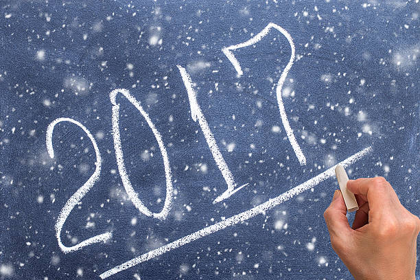 year on chalkboard with hand writing underline 2017 - sprüche zum firmenjubiläum stock-fotos und bilder