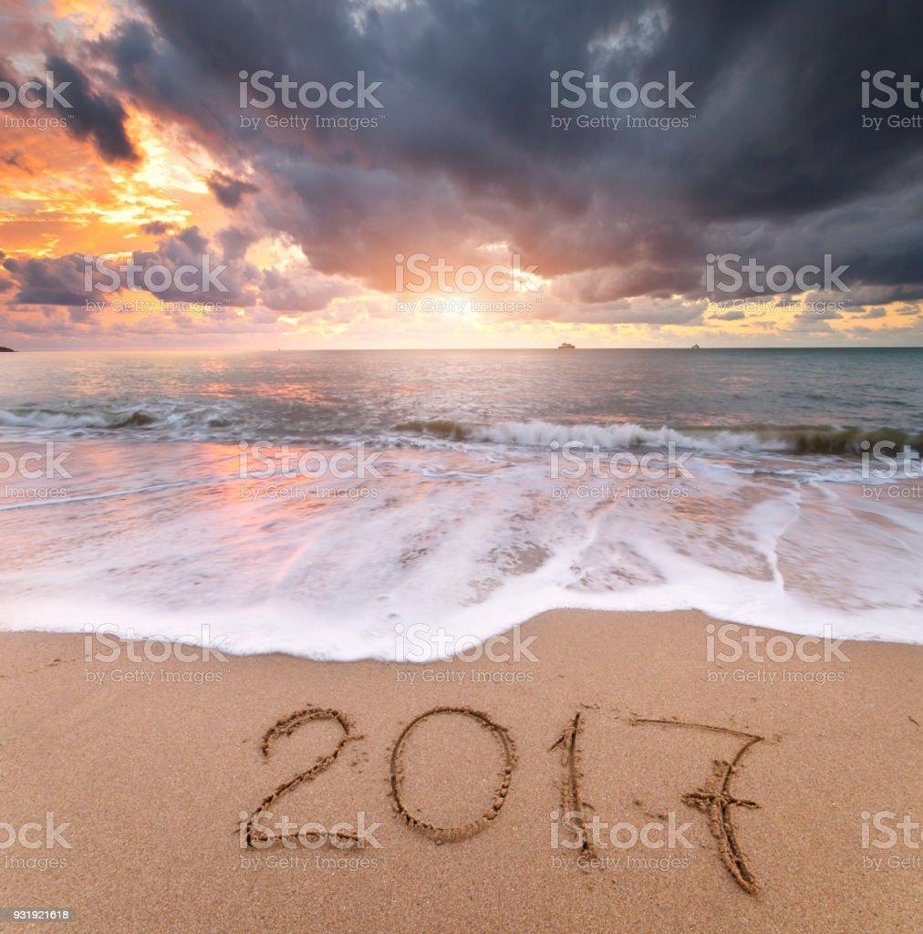 2017 year on the sea shore. stock photo