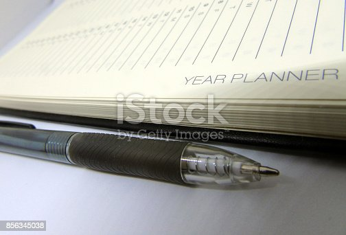 istock Year Planner Diary & Pen Isolated on White Background 856345038