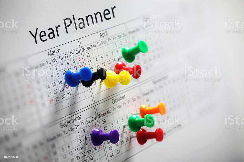 Planejador com thumbtacks ano - foto de acervo