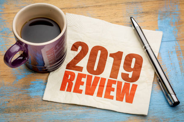 2019 year review on napkin 2019 year review text on a napkin with a cup of coffee, end of year business concept modern period stock pictures, royalty-free photos & images