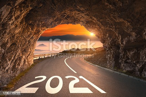Driving through tunnel forward to upcoming 2021 new year. Concept for success and future.